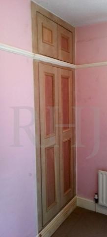 Wooden construction storage doors